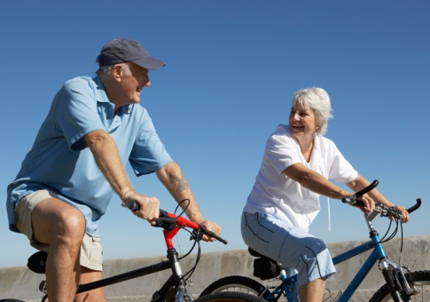 senior citizens riding bikes together