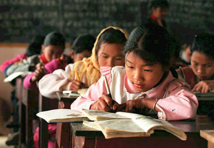 Asian children in a classroom working
