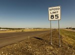 a highway sign in Texas showing the 85 mph speed limit