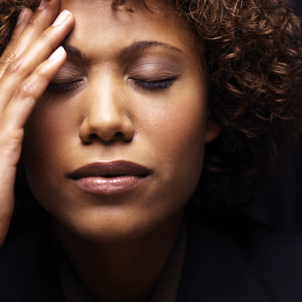 a stressed-out woman with a headache