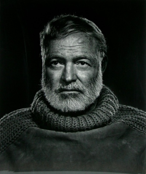 ernest hemingway with a manly beard and sweater